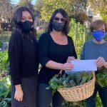 Elaine Ross hiving a donation for Long Beach Organic Community Gardens.