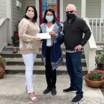 William and Elaine Ross presentin a check to Waymakers Huntington Beach from the William Ross Family Foundation