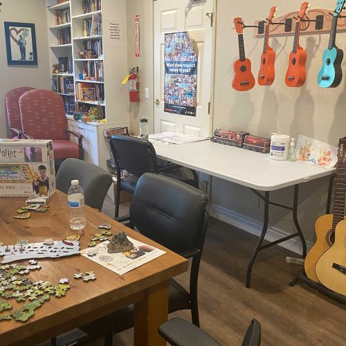 Activites room at the Waymakers Huntington Beach Shelter with guitars and jigsaw puzzles.