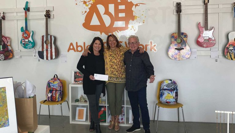 Elaine and Bill Ross making a donation to Able Arts Work.