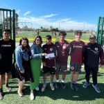 Elaine Ross presenting the sponsorship check for 2 children to play with CDA Slammers FC