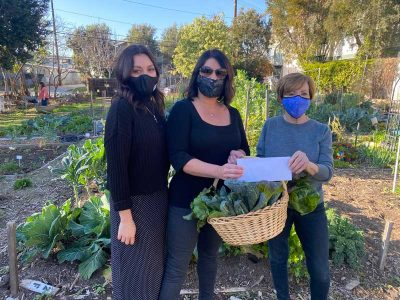 e RoEss presentinh a check to Long Beach Organic Commumity Garden